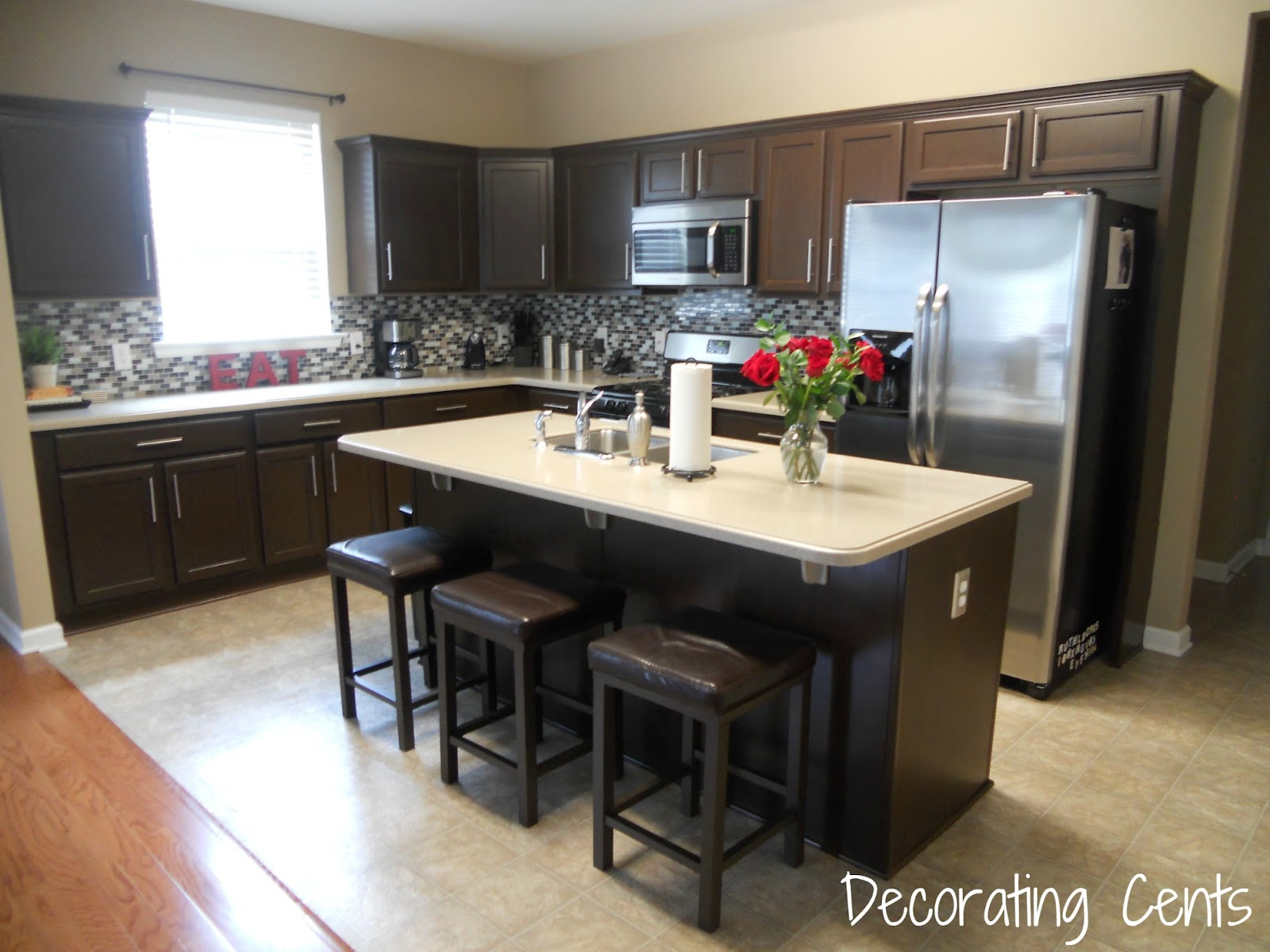 Decorating cents kitchen cabinets revealed for Dark brown painted kitchen cabinets