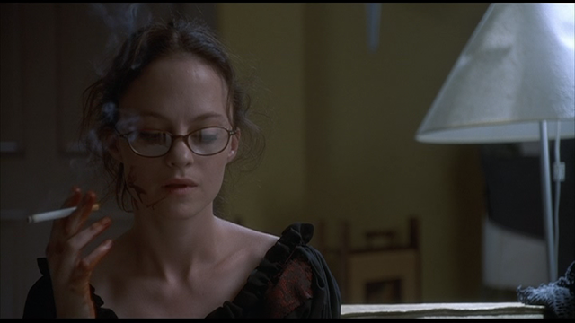 MAY (2002): May (Angela Bettis) smokes a cigarette after her first kill