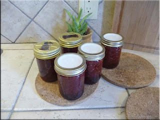strawberry jam sealed with Tattler and glass inserts just out of canner