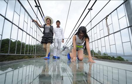 World's longest glass suspension bridge opens in China