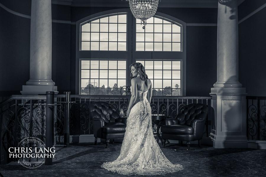 image of bride inside the River Landing Clubhouse under chandelier -  Ballroom weddings -  Elegant wedding picture - wedding ideas - bride resources