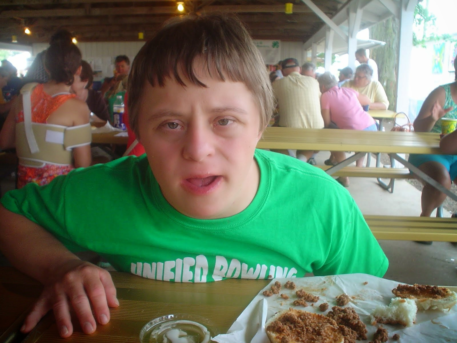 Alec eating at the Clinton County Fair
