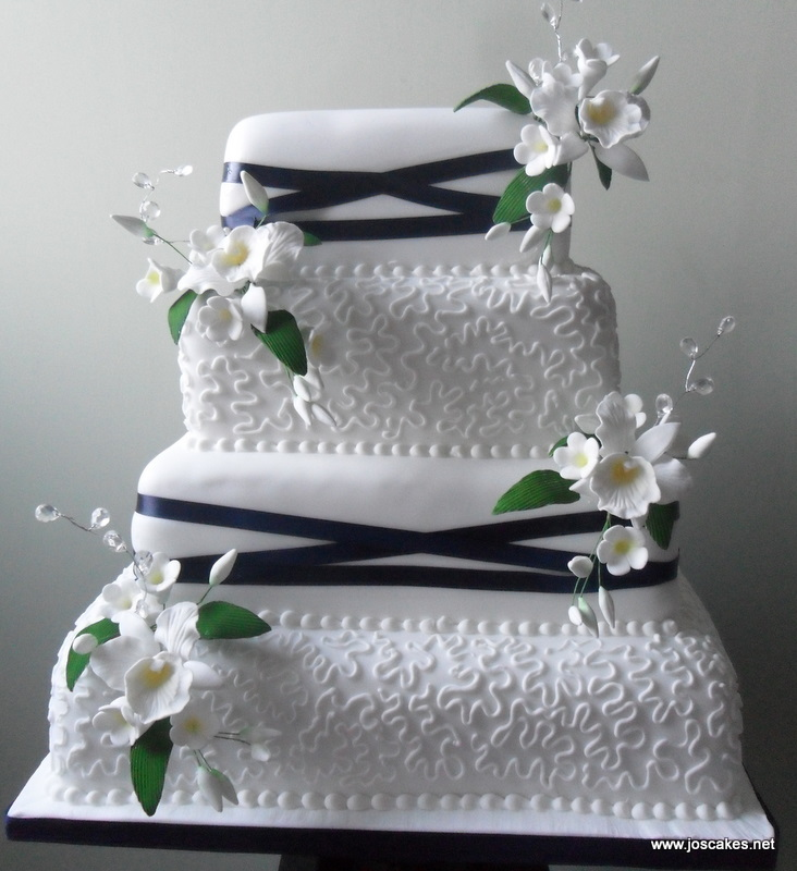 Four Tier Lace and Ribbons Wedding Cake