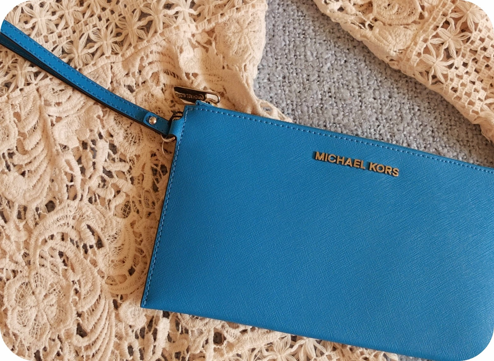 Michael Kors Jet Set Sky Blue Leather Clutch on British Fashion Blog