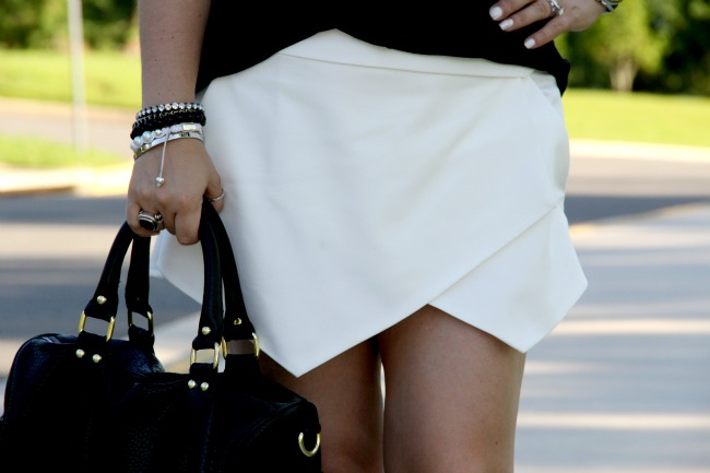 White Asymmetric Shorts - Zara, Black Top - TJ Maxx, Accessories - Boy Meets Girl, Joseph Nogucci and some for my closet, Necklace - Nordstrom, Black Onyx and Silver Ring - David Yurman, Angled Enamel Sunglasses - Marc Jacobs, Bag - Steve Madden via Nordstrom Rack, Revlon Fuchsia Shock 815 and Super Lustrous Lipgloss Pink Pop