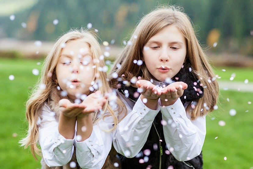 blowing confetti in photographs photo