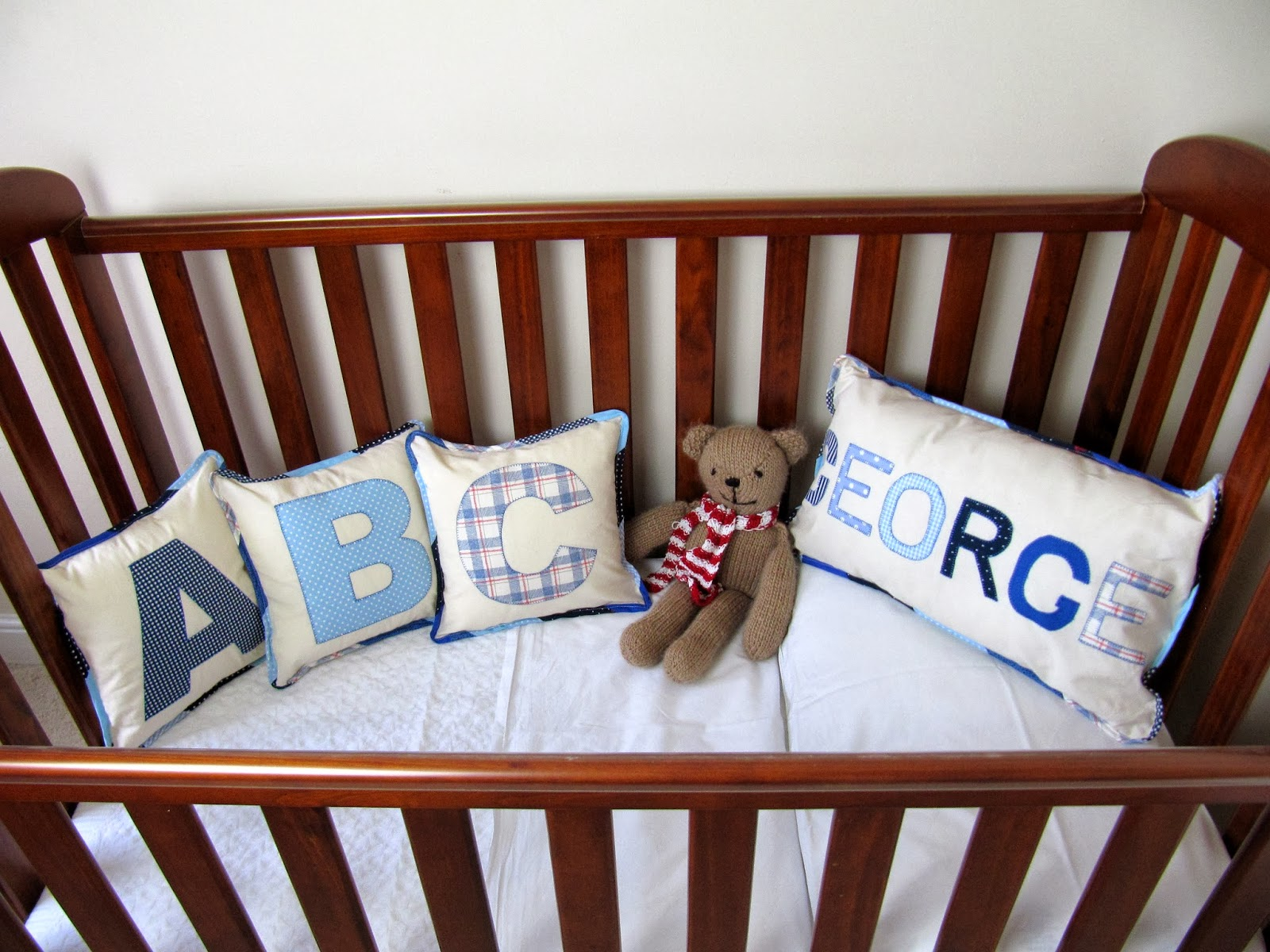 cot with letter pillows
