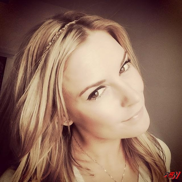 Renee Young Showing Off Her New Headband.