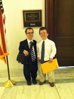 two men of short stature standing outside Senate Office Door