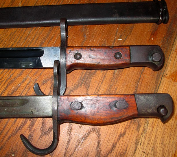 the upper is a issue bayonet.  Lower is issue