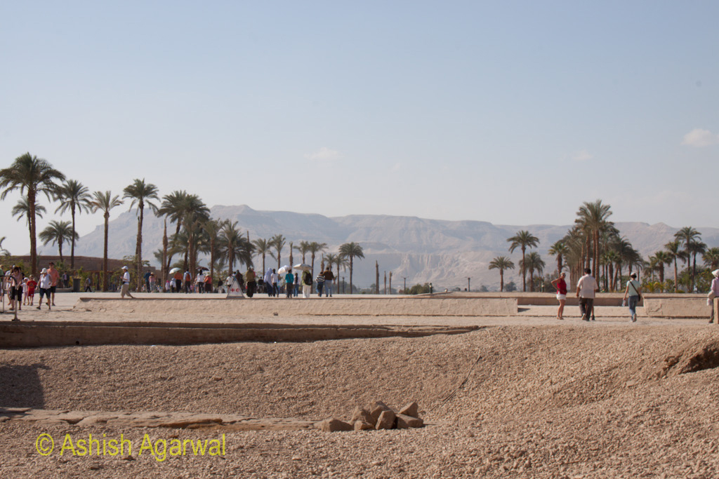View of hills in the distance along with the path in front of the Karnak temple in Luxor