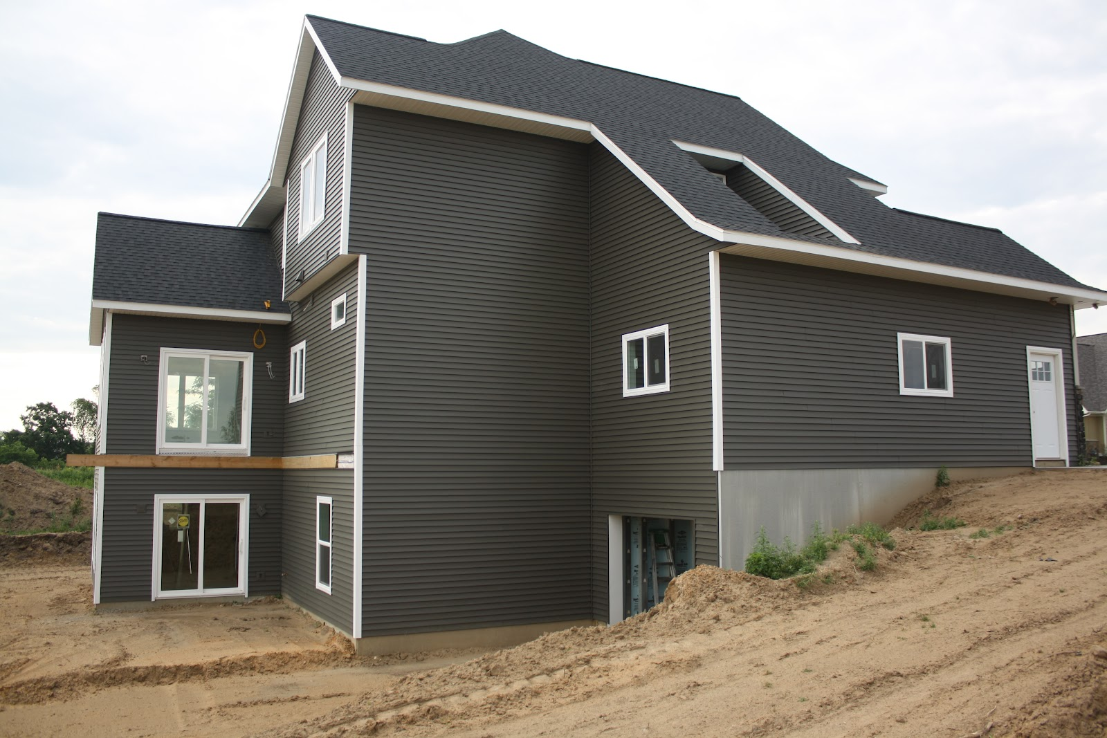 House on tufton the build exterior stone siding and for House siding designs