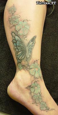 fotos de tatuagens de Borboletas na Perna com flores