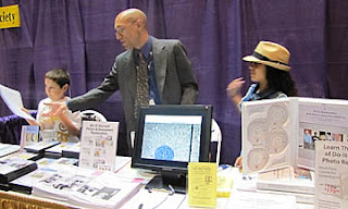 Working hard at the Federation of Genealogical Societies Photo Grafix table