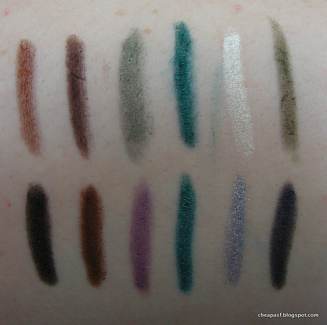 TOP ROW (left to right): ULTA eyeliners in Copper, Mink, Olive Oil, Peacock, Halo, and Moss. BOTTOM ROW (left to right): Urban Decay Zero, Urban Decay Whiskey, Urban Decay Ransom, Revlon Emerald, Starlooks Topaz, Tarina Tarantino Cute Robot