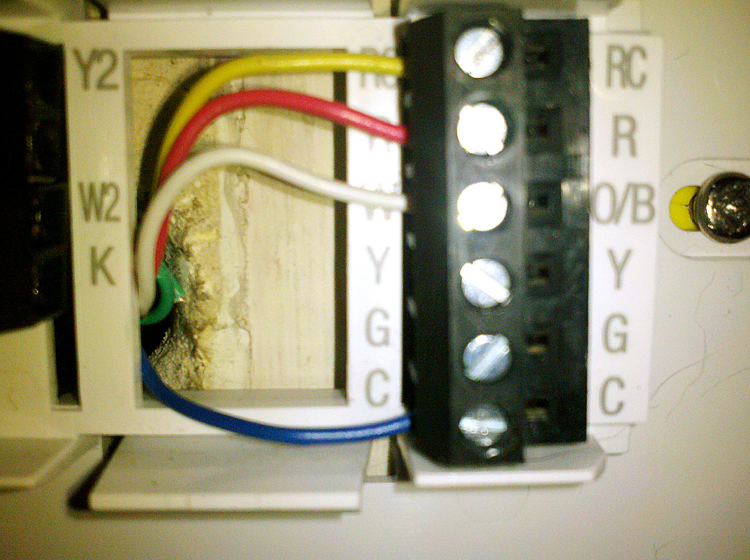 how to add c wire to thermostat the picture didn t come out quite as straight but you can see how the 4 wires attach to the thermostat s base plate