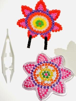 http://www.kidsfeestje.nl/kado/kado-creatief/38850_art_4mod3437_strijkkralen-setjes-figuren.html#