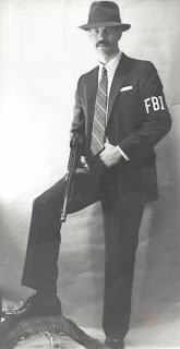 Denham poses as an old school FBI agent.