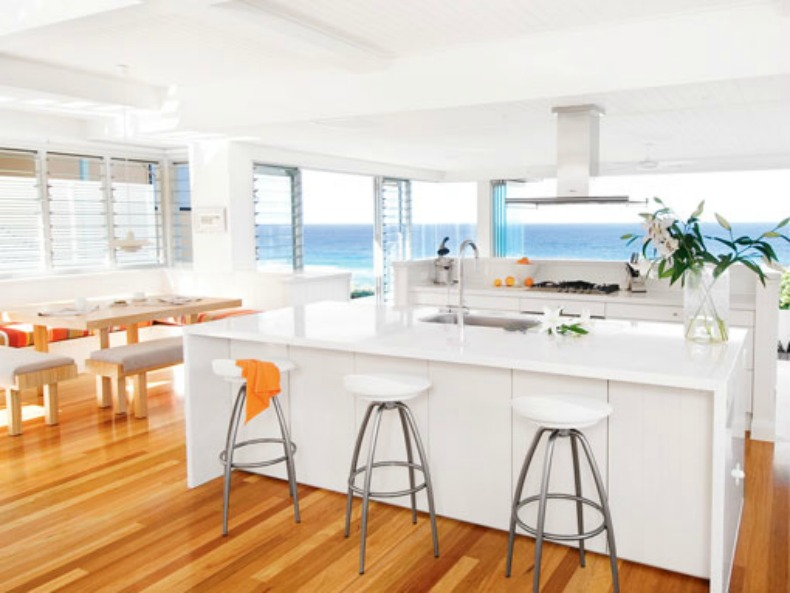 bright white modern coastal kitchen with an ocean view