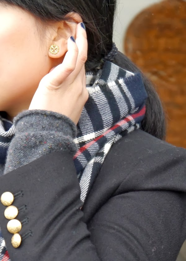 Details: fancy gold stud earrings, navy nails, gold buttons, plaid scarf