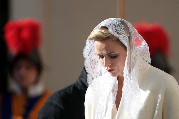 Princess Charlene of Monaco and Prince Albert II of Monaco arrives at the Apostolic Palace for an audience with Pope Francis on January 18, 2016 in Vatican City