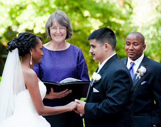 Robert and Patricia look at each others with loving eyes at their ceremony