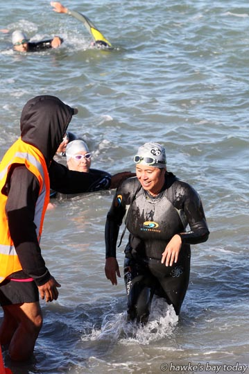 End of the first lap for team swimmers - Half Iron Maori at Pandora Pond, Napier.  photograph