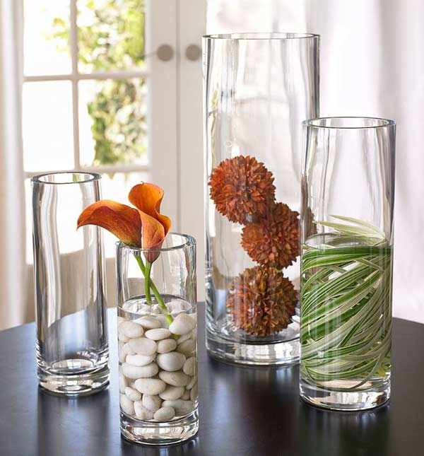 These natural table arrangements use flowers, rocks, and leaves