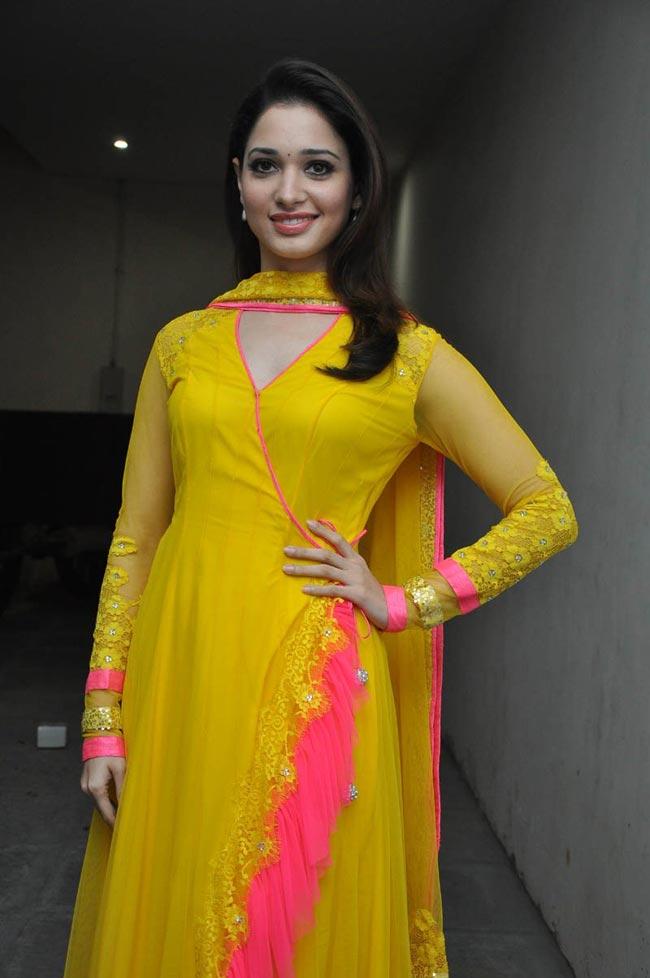 Tamanna Hot In Yellow Saree Tamanna at mr pellikoduku audio launch ...