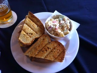 """Photo of """"The Rodeo"""" - a pulled pork with Mac & Cheese sandwich with side of pasta salad by Don Taylor"""