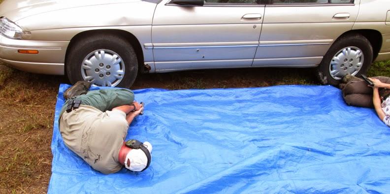 shooting under car