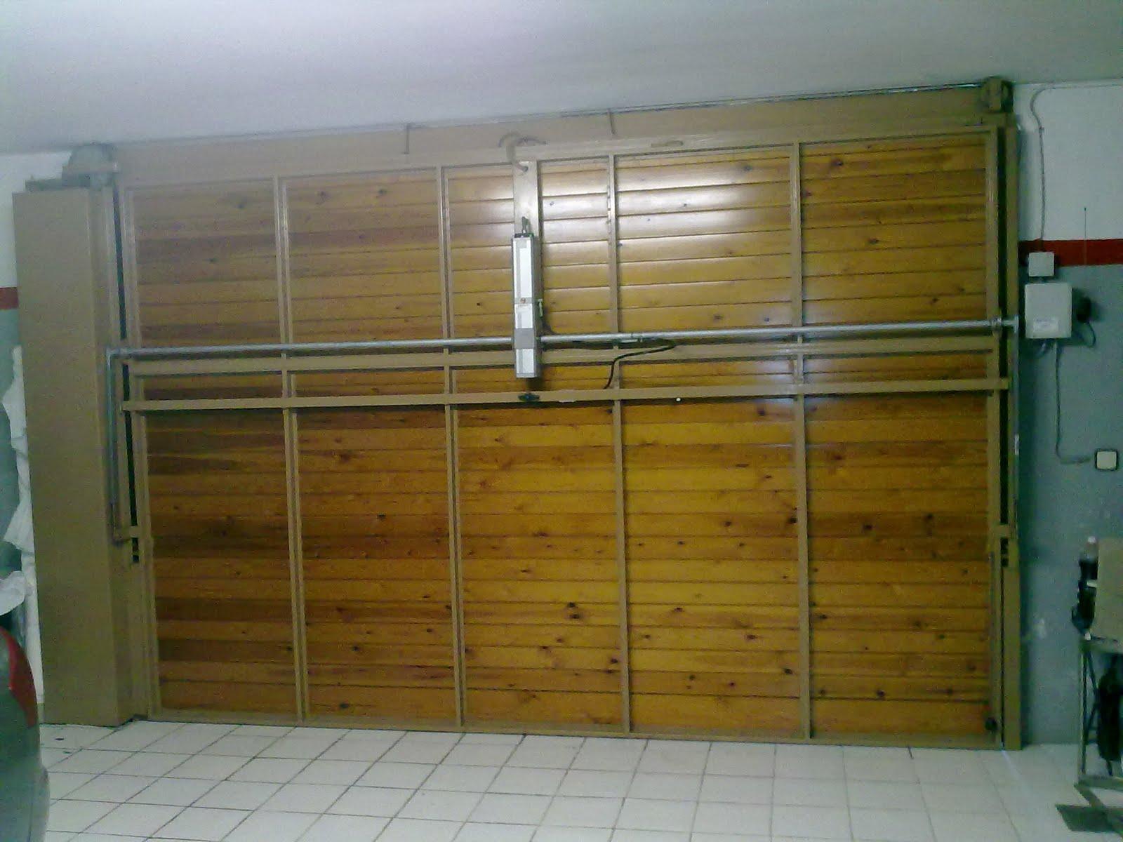 Puertas automatismos seguridad y control barcelona for Automatismos para puertas