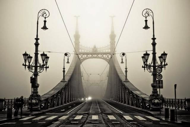 Budapest is actually composed of two sections, Buda and Pest, and this is the bridge that connects them across the River Danube. The four masts, barely visible here in the fog, are topped with the Turul, a falcon that features in Hungarian mythology.