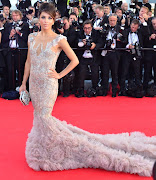 Cheryl Cole wowed the crowds in a gorgeous Stephane Rolland feathered gown.