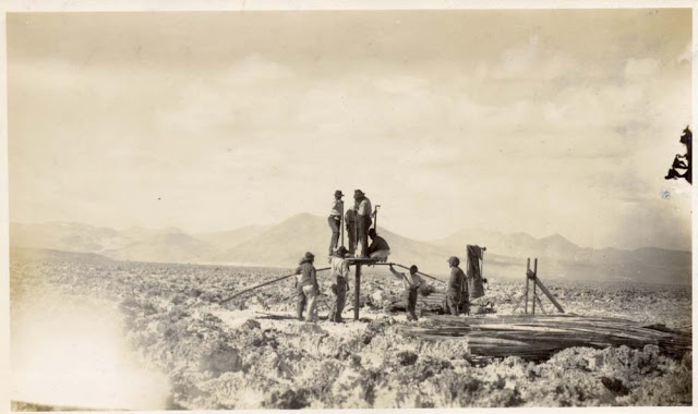 Commencing work with the 'Empire' drill. Unknown location, Chile. From the W.J. Reynolds Collection. c. 1922.