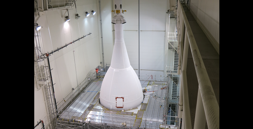 A fully assembled Orion stands 72 ft tall inside the Launch Abort System Facility (LASF) at Kennedy Space Center. The spacecraft will remain inside the LASF until it rolls to launch pad 37 in November. Credit: Lockheed Martin