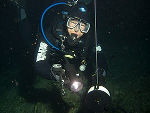 Diving instructor from Scuba Tech, guides a night dive in Cyprus