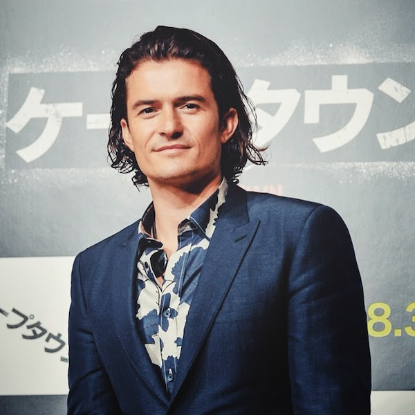 Orlando Bloom wears Burberry Prorsum Fall Winter 2014 blue floral shirt at the press conference for the Japan premiere of ZULU.jpg