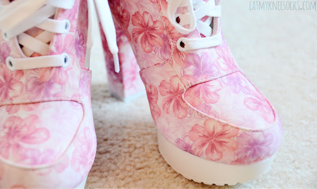 Close-up on the cute pink-and-white floral print platform lace-up booties from AMIClubwear.