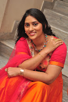 Sri Sudha in a lovely orange Anarkali Dress