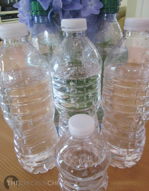 Freeze various sizes of water bottles and jugs and add them to waterers throughout the day. Chickens will drink more water when it is cool than if it isn't.