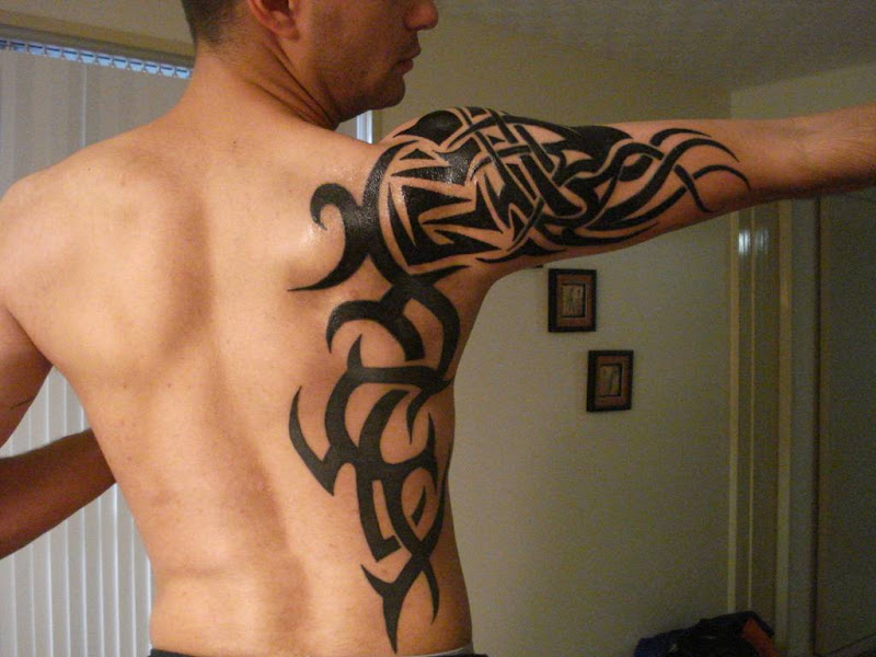 Tribal Tattoos for men title=