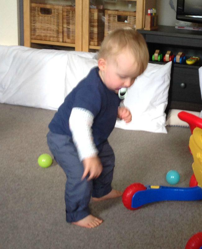 Baby bending down