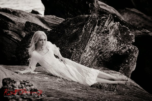 Modelling portfolio, Romantic thoughtful moment, Sydney Harbour park, rocks and water, Kent Johnson Photography.