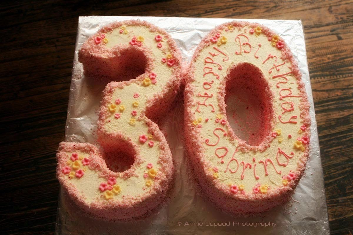 celebration cake in the shape of 30