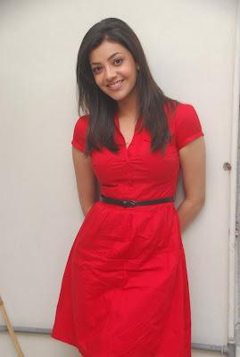 Cute Kajal Agarwal in Red Short Skirt Looking Like a Santa Girl