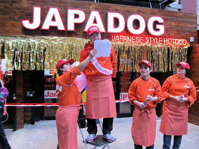 Noriki Tamura a respresentative of Japadog New York City makes an announcement
