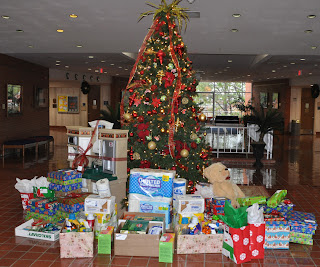 Presents around the College of Criminal Justice Christmas tree