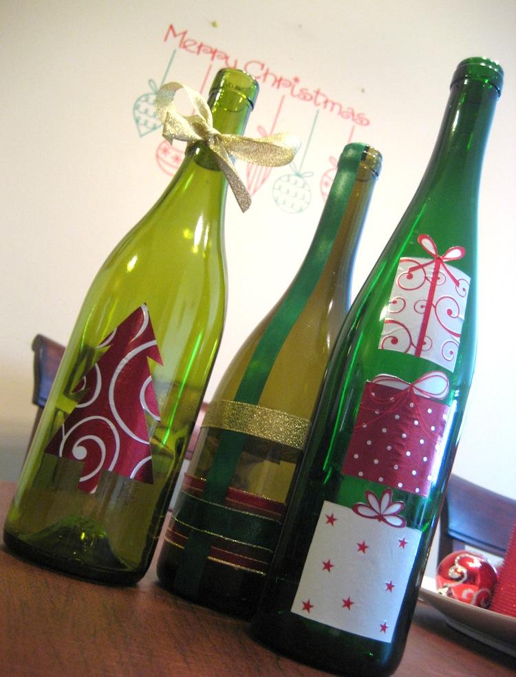 Wine bottle decor christmas craft mod podge rocks for Christmas bottle decoration ideas