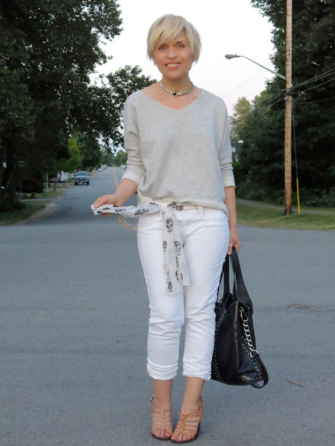 styling white jeans with a sweatshirt, strappy sandals, and a scarf-as-belt!